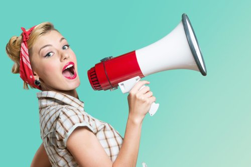 Megaphone. Attractive woman with megaphone